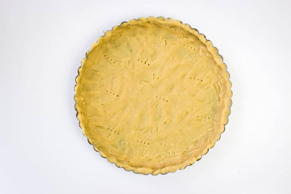 press keto pie dough into a pie or tart pan