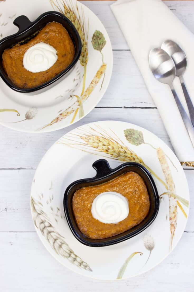 ketp pumpkin custard in a ramekin on a plate with spoons