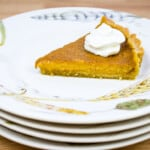 slice of keto pumpkin pie on a stack of plates