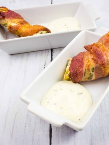 ranch keto jalapeno poppers on a serving dish with sauce