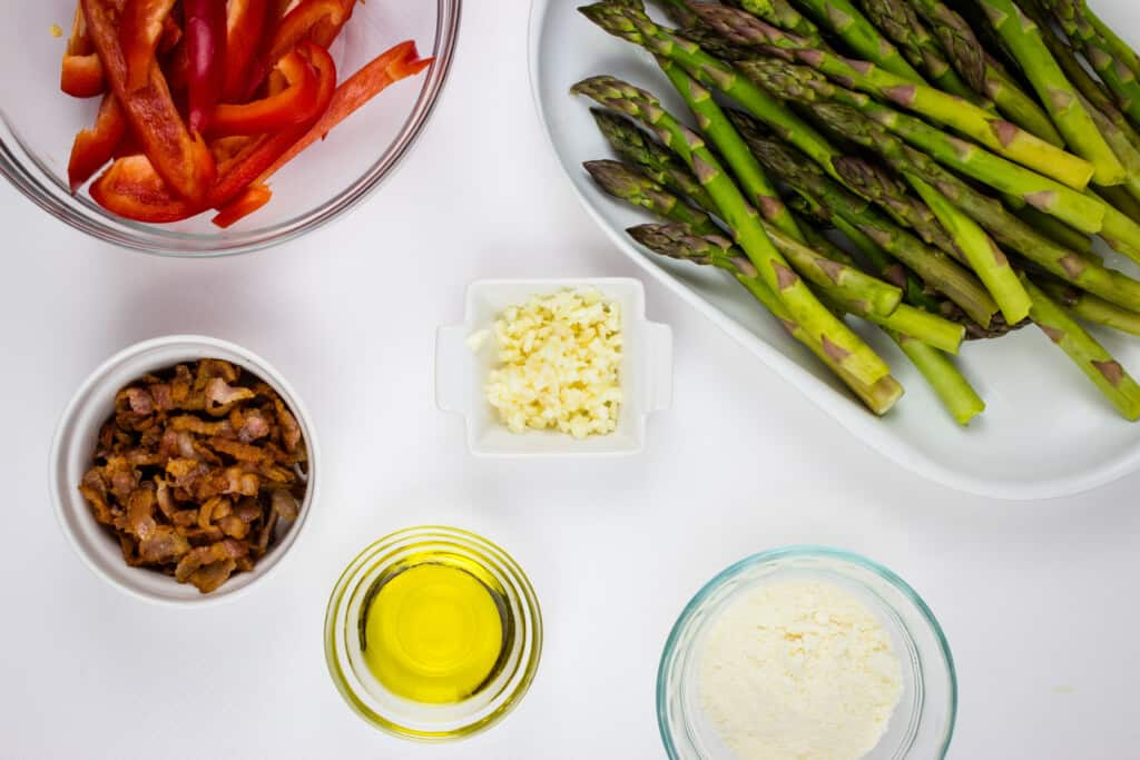 prepped ingredients, asparagus, bacon, bell pepper, garlic, parmesan cheese
