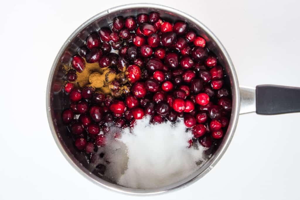 add berries, sugar subistitute, cinnamon and water to a saucepan