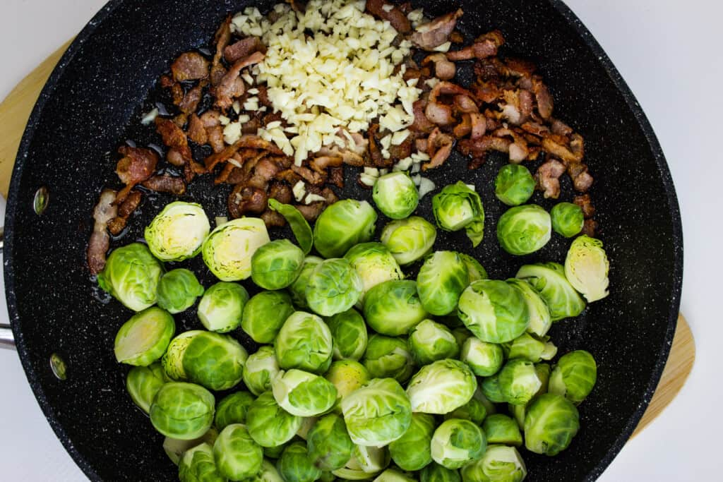 add brussels sprouts to bacon fat and cook in skillet