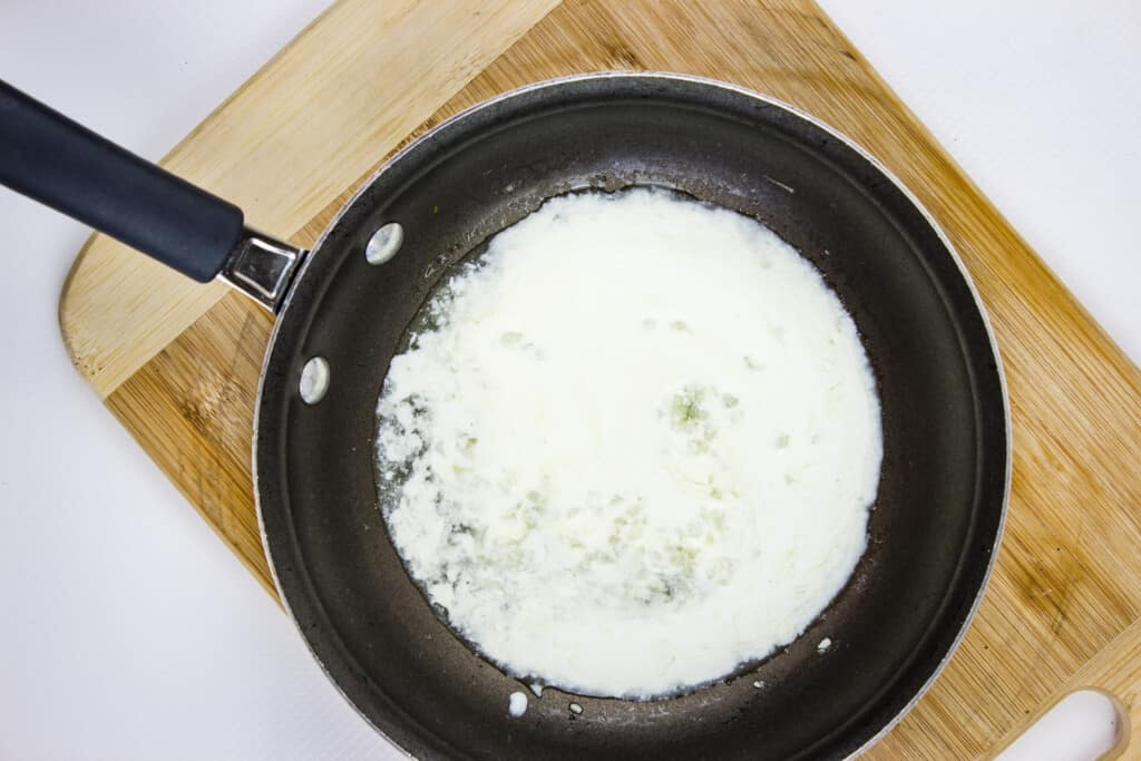 add the cream to the skillet
