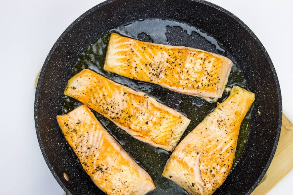Sautee the seasoned salmon filets in a bit of cooking oil and set aside