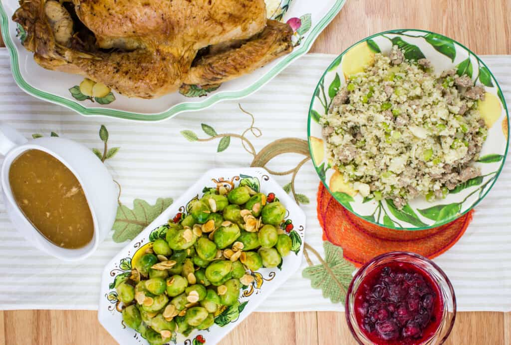 cranberry sauce, turkey, gravy and more in a keto thanksgiving feast