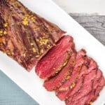 keto smoked beef tenderloin sliced on platter