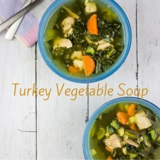 leftover turkey soup in bowls with spoons