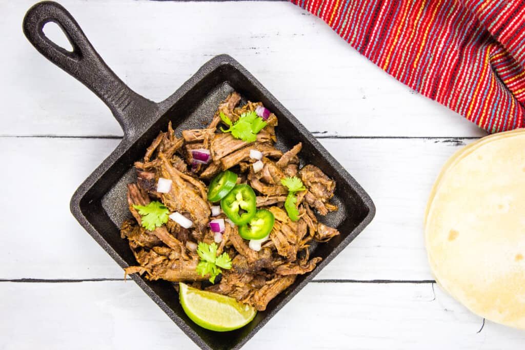 keto beef barbacoa in a square serving dish