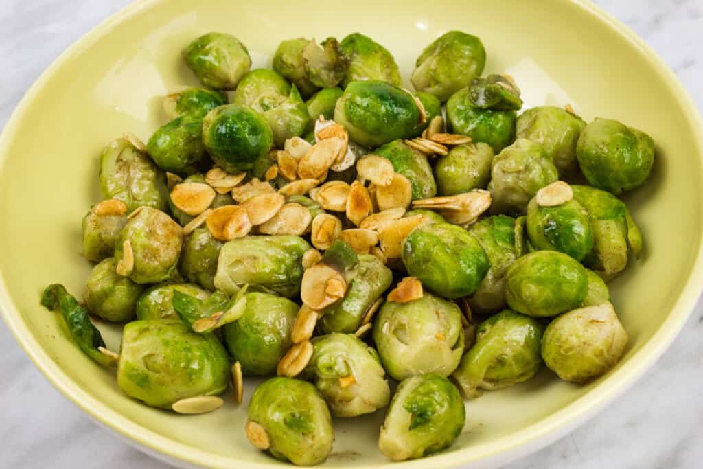 keto brussels sprouts with almonds & brown butter in a serving dish