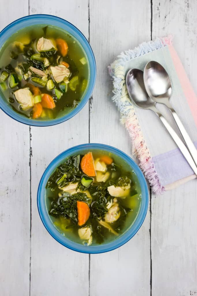 keto leftover turkey vegetable soup in bowls with spoons
