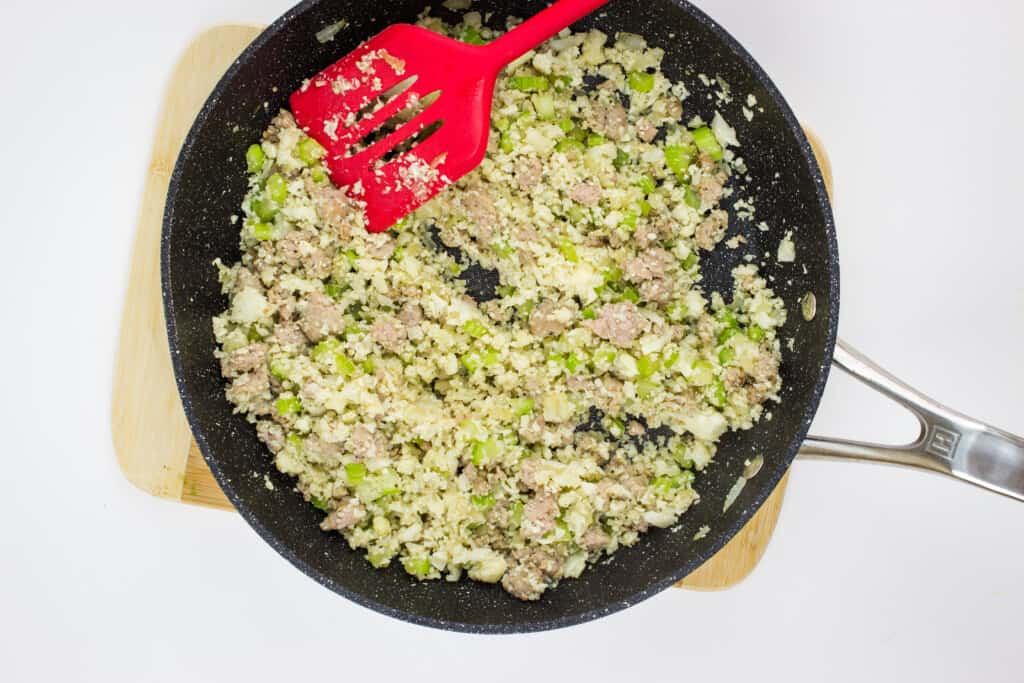 keto stuffing cooked in a skillet with a red flipper