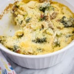 keto keto broccoli casserole with turkey in a casserole dish