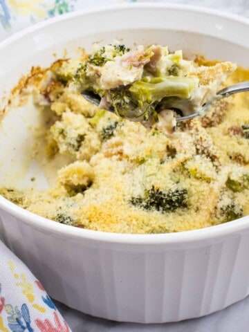 keto turkey broccoli casserole in a white casserole dish