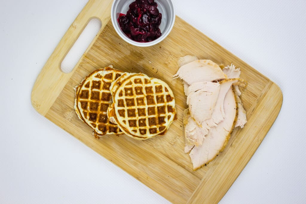 load your chaffle with sliced turkey and cranberry sauce