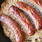 keto sauerkraut and sausage in a cast iron pan