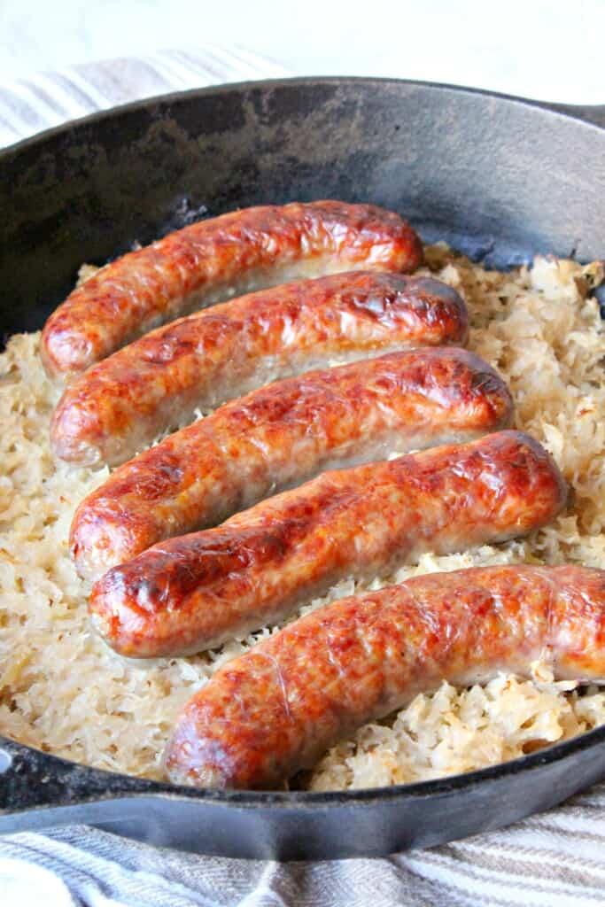 keto sauerkraut and sausage in a cast iron baking dish