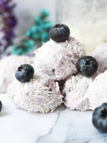 blueberry keto fat bombs on a platter