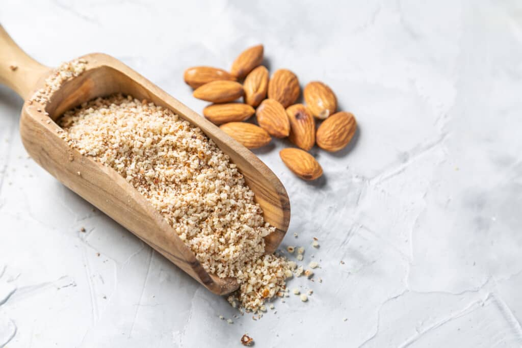 almonds and almond flour on a spoon