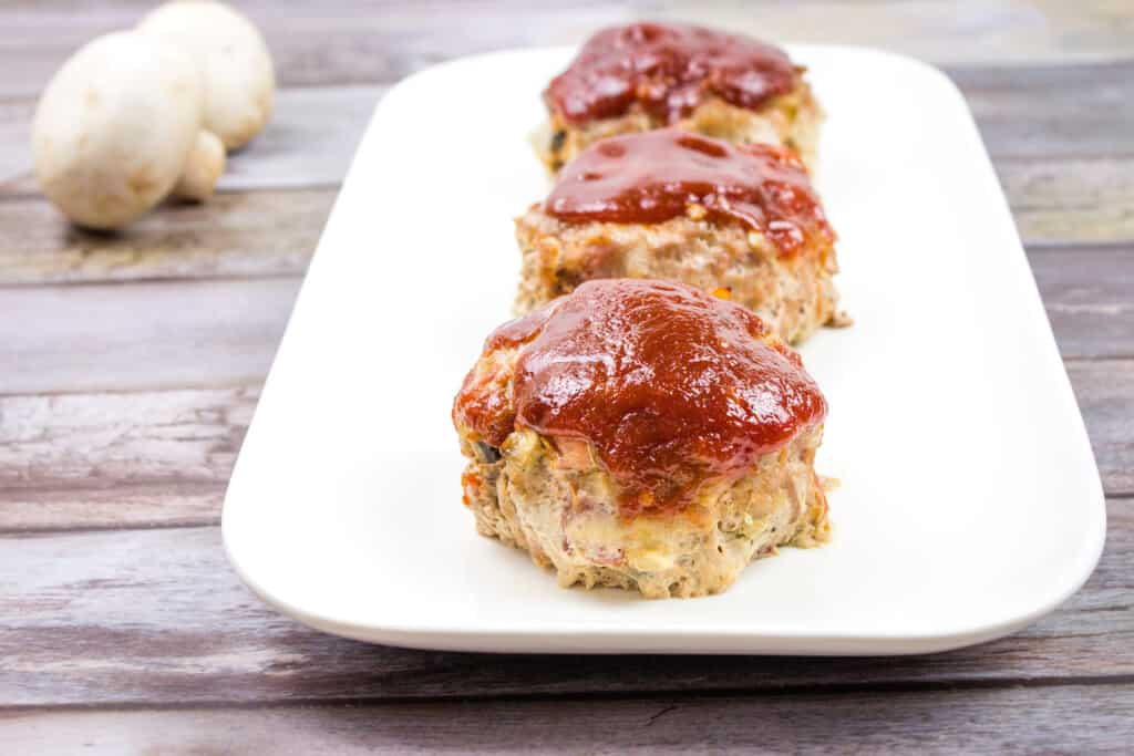 easy mini keto meatloaf on a white serving tray