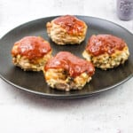 the best mini keto meatloaf recipe on a black plate
