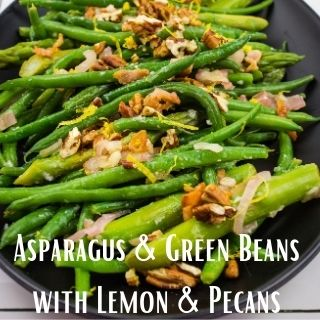 Asparagus & Green beans with Lemon & Pecans on a black serving plate