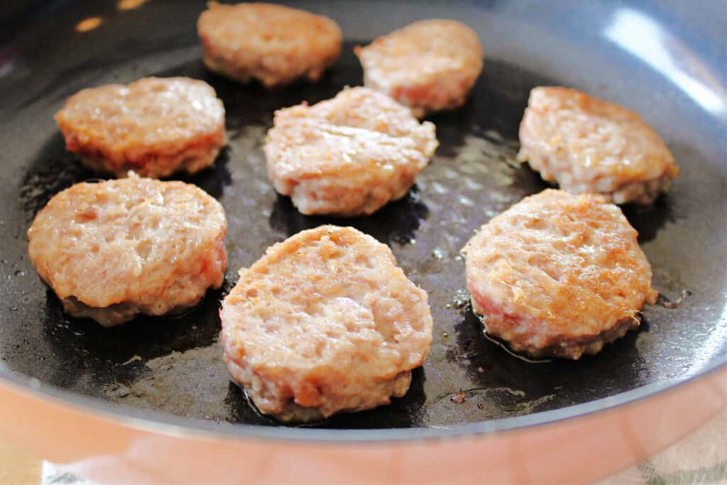 frying the sausage patties