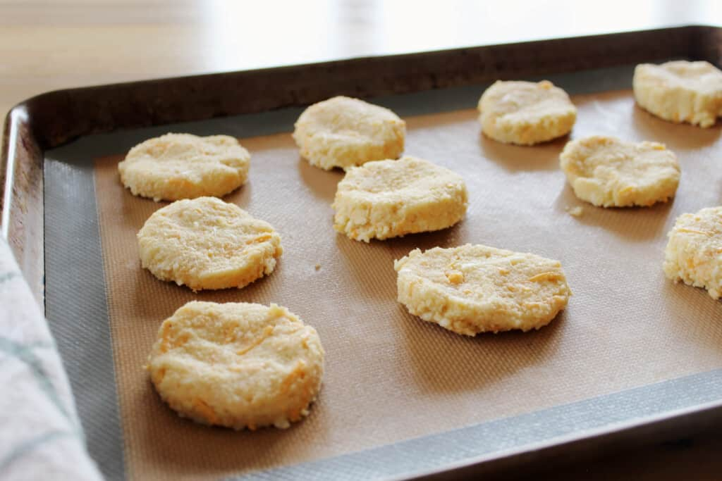 cut biscuit rounds on a lined sheet pan