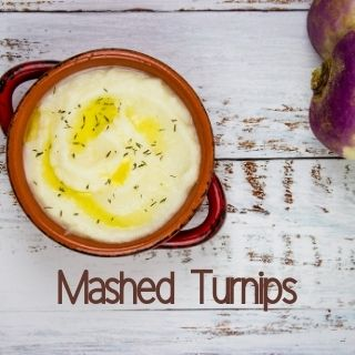 mashed turnips in a rustic bowl with turnips in the background