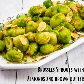 brussels sprouts with brown butter in a serving bowl on a wooden table