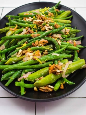 keto asparagus and green beans on a black plate