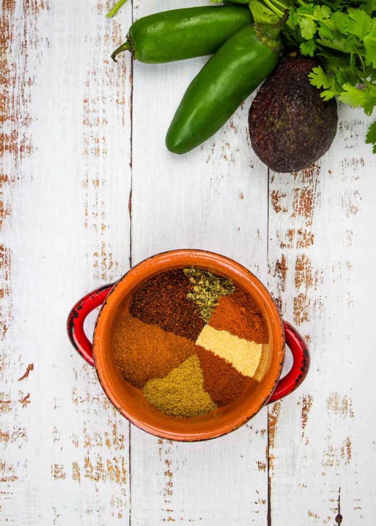 keto chili spice mix on a table with veggies in the background