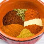 keto chili spice mix in a bowl with the different spices side by side