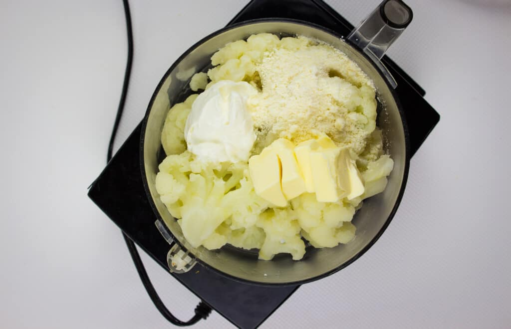 add the keto cauliflower mash ingredients to the food process and pulse until smooth