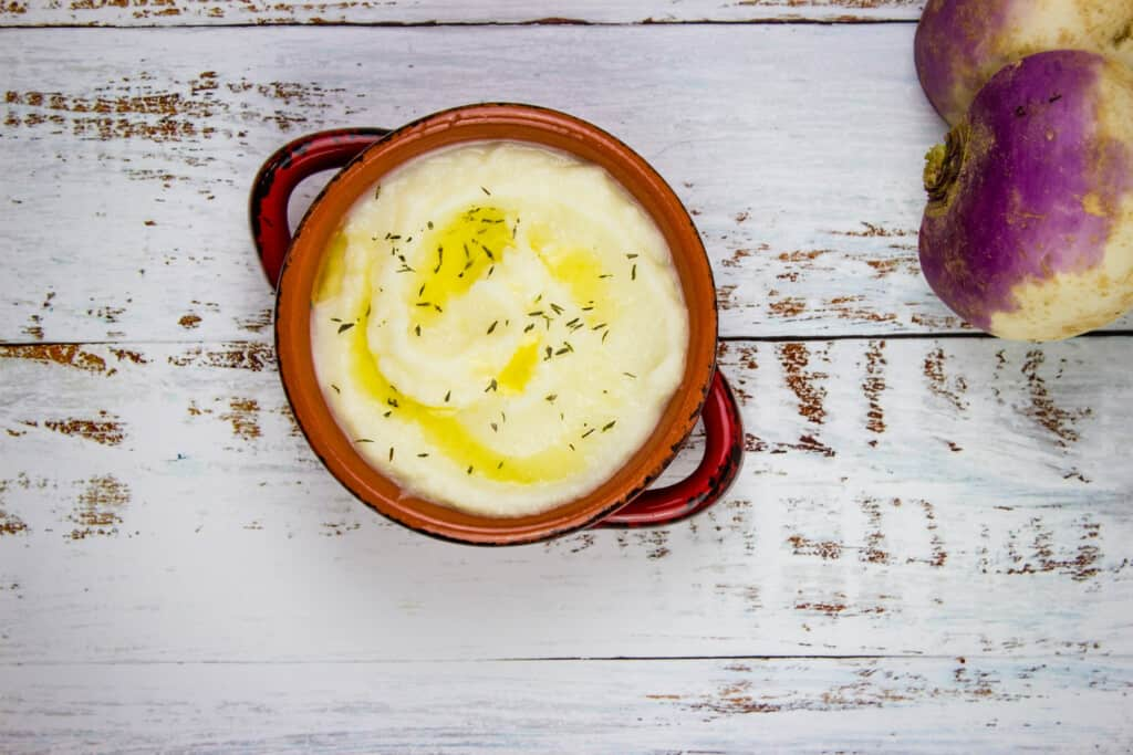 mashed turnips in a serving bowl