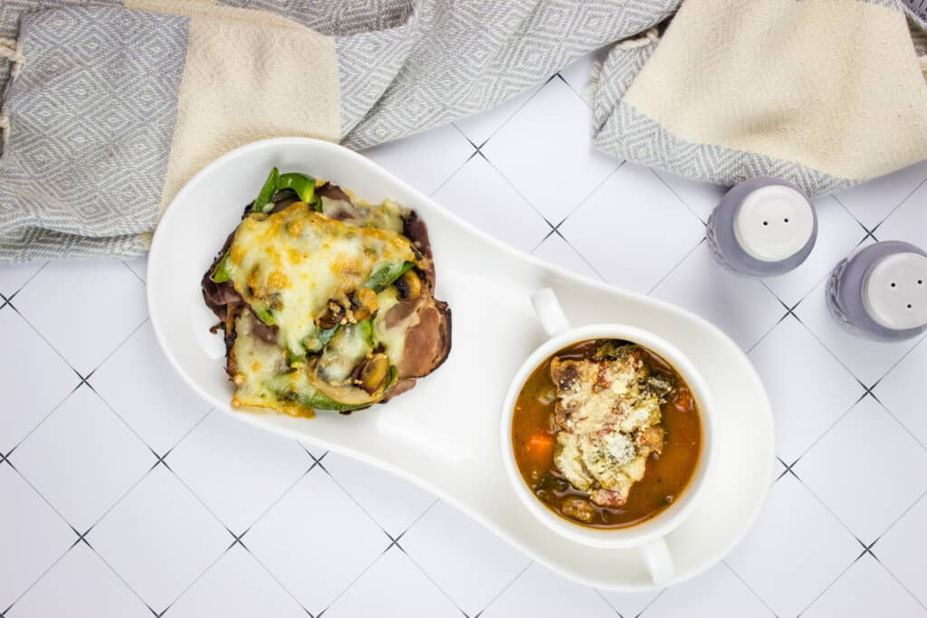 keto philly cheesesteak stacks on a plate with beefy minestrone soup
