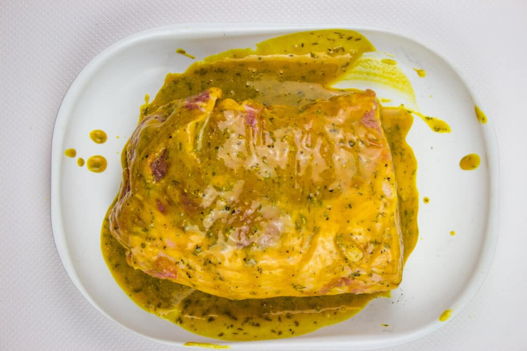 Brown sugar mustard glaze pork loin roast covered in glaze.
