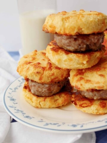 a stack of keto sausage biscuit sandwiches on a plate
