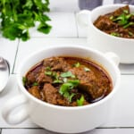 hungarian keto goulash in white serving dishes