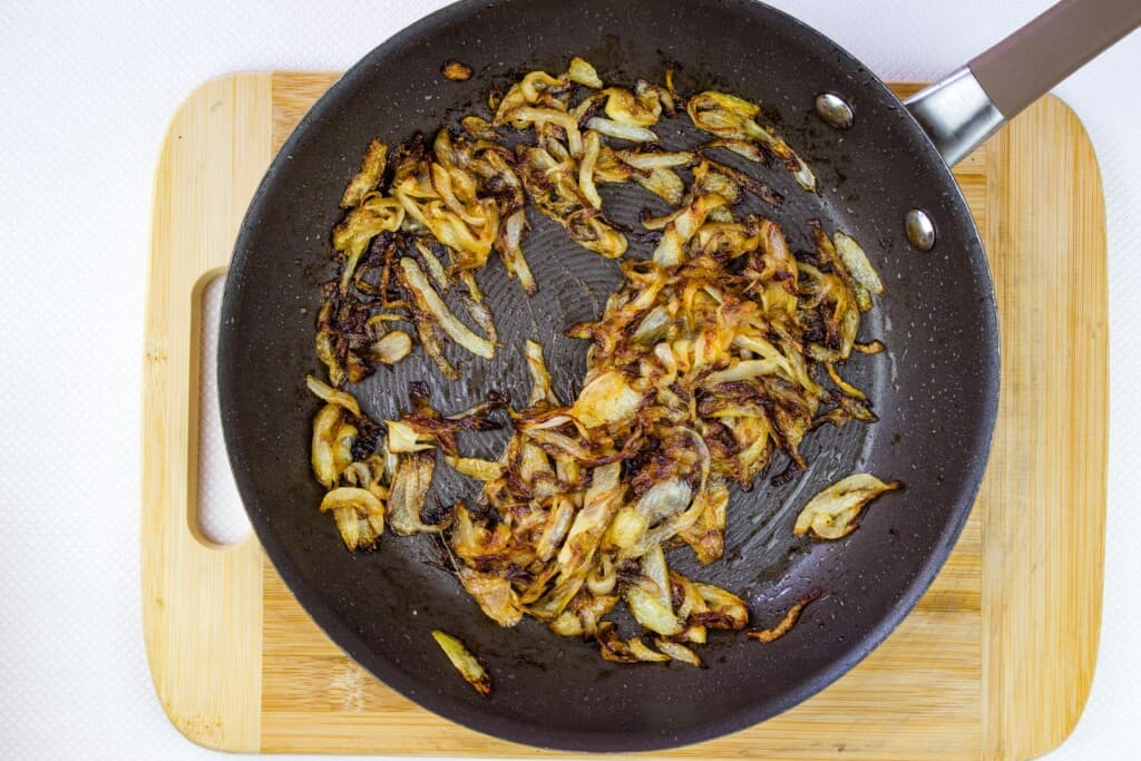 caramelized onions in a black skillet