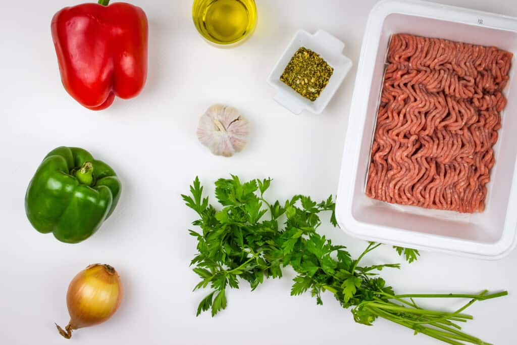Ingredients to make Italian ground turkey and peppers.