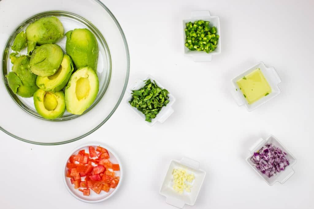 prepped ingredients to make keto guacamole