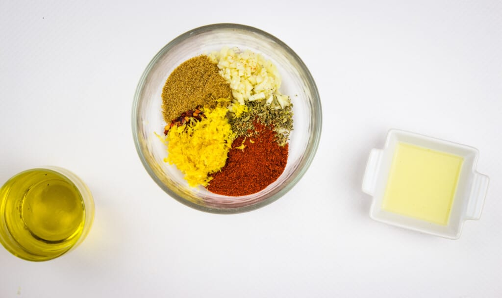 Mixing the garlic and the spices to make the rub for the oven-roasted peruvian chicken reicpe.