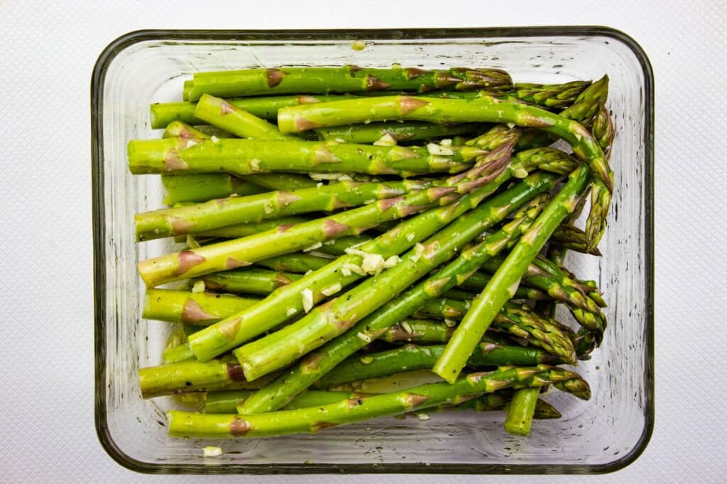 Asparagus tossed with oil, salt and pepper, and garlic.