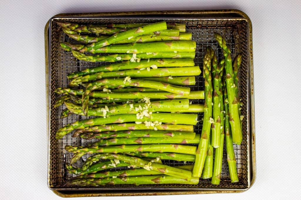 Arrange in the air fryer and cook until tender crisp.