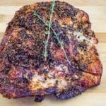 whole air fryer turkey breast resting on a cutting board