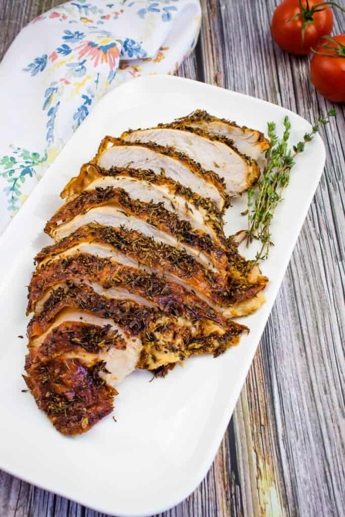 air fryer turkey breast on a white platter