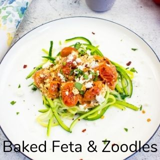 baked feta with tomatoes on a bed of zoodles
