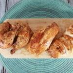 roasted cajun chicken on a cutting board