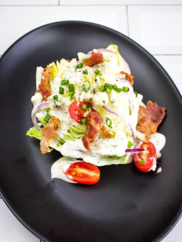 keto wedge salad topped with keto blue cheese dressing